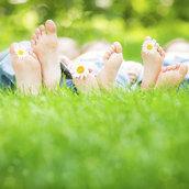 Family lying on grass wallpaper