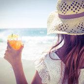 Girl wearing a straw hat wallpaper